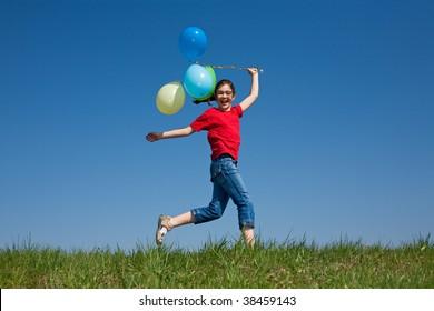 Girl holding balloons, playing outdoor