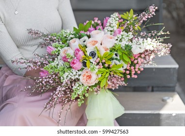 the girl holding a beautiful delicate bouquet
