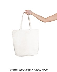 Girl is holding blank canvas tote bag, design mockup. Handmade shopping tote bag for girls.