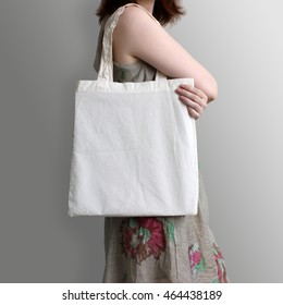 Girl is holding blank cotton eco tote bag, design mockup.
