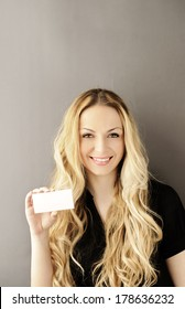 Girl holding blank membership card