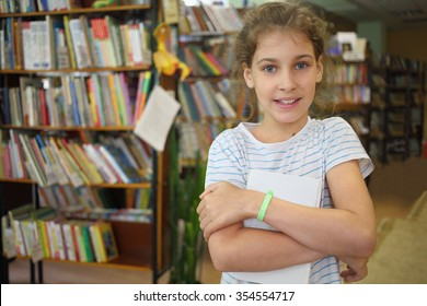 Girl holding a book in the childrens library