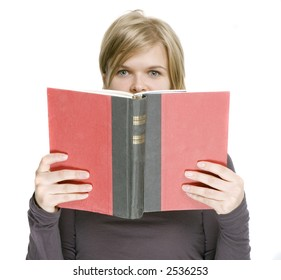 a girl is holding a book in front of her face