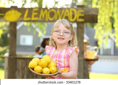Girl holding bowl of lemons