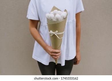 Girl holding cake pops bouquet.