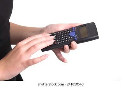 Girl holding calculator in hands in studio isolated