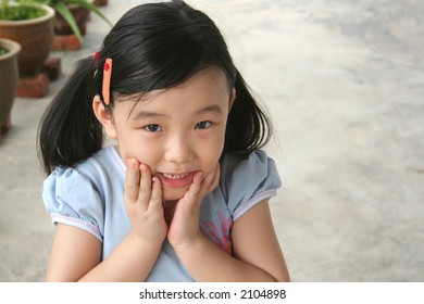 Girl holding chin showing surprised and shocked expression