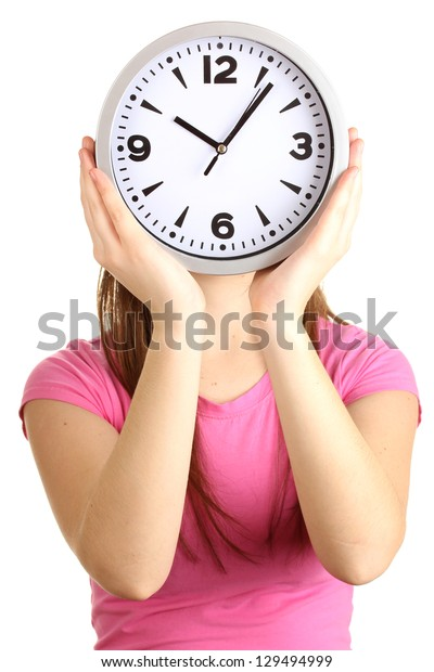 Girl holding clock over face isolated on white