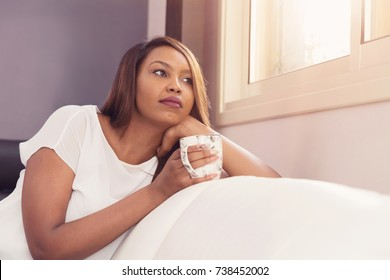 Girl Holding A Cup of Coffee Enjoying The Quiet Morning