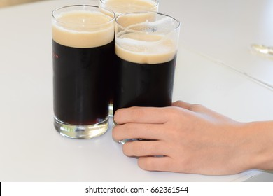 Girl Holding Dark Beer Glass