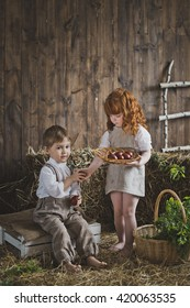 Girl holding dish with painted eggs.