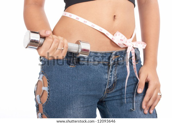 girl holding dumbell with a perfect figure
