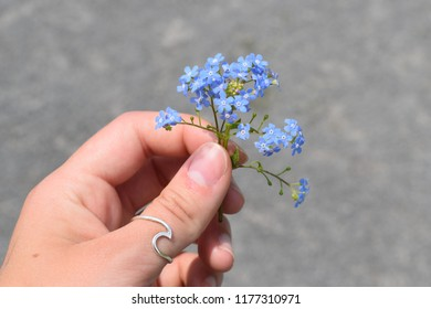 Girl holding flowers with wave wing