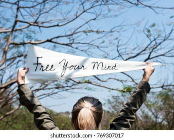 Girl holding free your mind flag banner