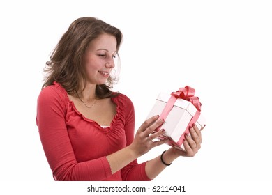 Girl holding a gift and smiling, isolated on white background.