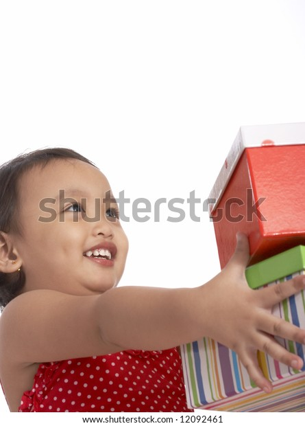 girl holding giftbox with a different colors