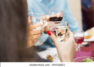 A girl holding a glass of champagne
