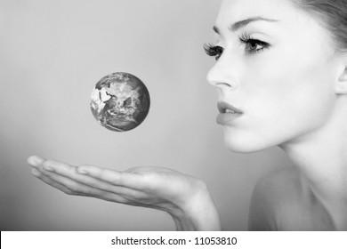 girl holding globe