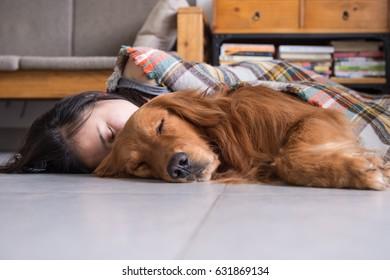 Girl holding the Golden Retriever to sleep