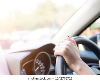 girl holding hand on wheel to handle the car, safety concept