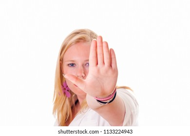 Girl holding hand up saying stop. Face visible