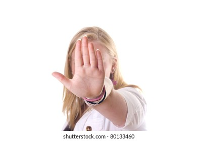 Girl holding hand up saying stop. No face visible