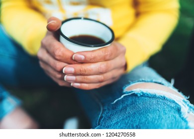 girl holding in hands cup of hot tea on yellow backgroung in outdoors nature park, beautiful woman hipster enjoy drinking cup of coffee closeup, lifestyle relax recreation meditation concept
