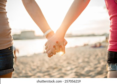 Girl holding hands on the beach