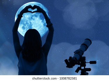 Girl holding a heart - shape with telescope, Moon and stars. My astronomy work.