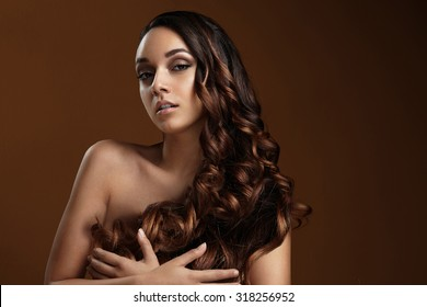 girl holding her curly hair