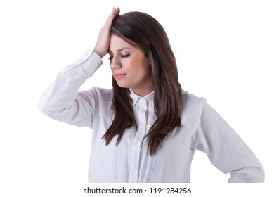 Girl holding her hand to her forehead in a sign of trouble, isolated in white