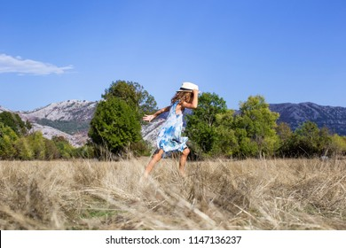 Girl holding her heat and running
