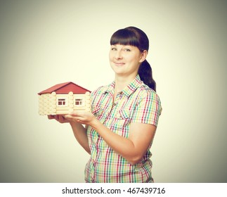 Girl holding a house on a white background.