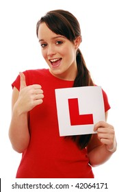 Girl holding 'L' plate and giving thumbs up
