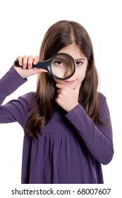 Girl holding magnifying glass