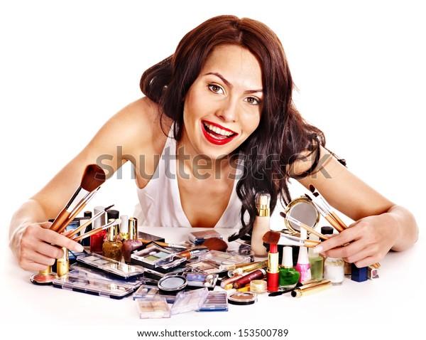 Girl holding makeup brush.  Isolated.
