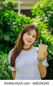 girl holding a milk tea