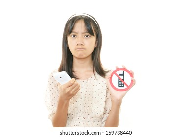 A girl is holding no mobile phones sign