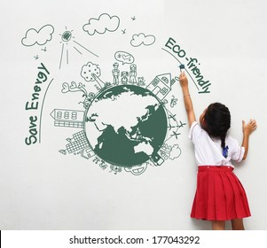 Girl holding a paint brush painting on a white wall with creative drawing eco friendly, save energy