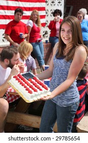 Girl holding a Patriotic cake