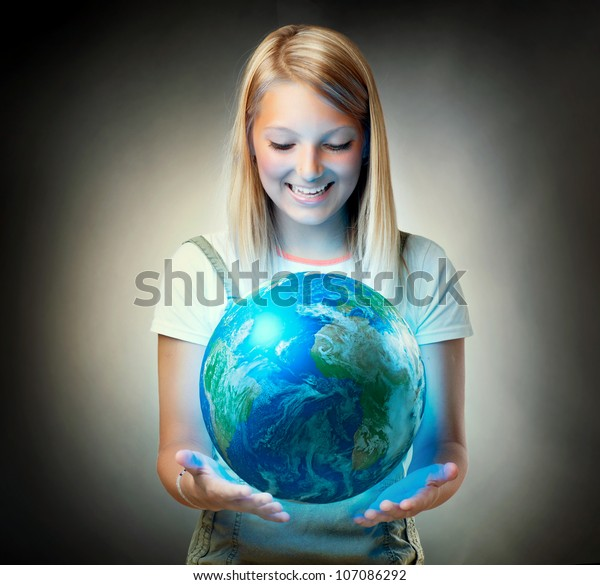 Girl holding the Planet  Earth. Future Concept