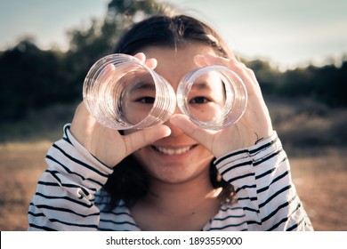 A girl holding plastic bottle, save the world from plastic concept