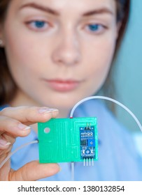 Girl holding polymers Bio-MEMS biomedical microelectromechanical systems / LOC lab-on-a-chip device (concept design)