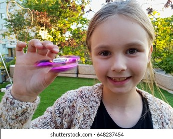 girl  holding popular fidget spinner toy