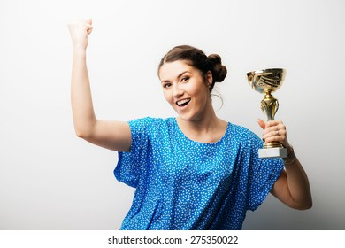 girl holding a prize cup