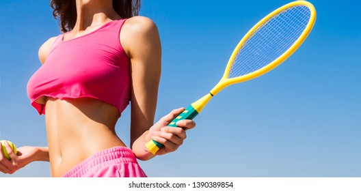 Girl holding racket. Of beautiful athletic girl in stylish sportswear holding racket in hand, to play tennis outdoors. Sexy tennis girl. Female tennis player with racket. Healthy lifestyle concept.