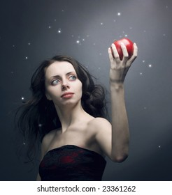 a girl holding a red apple