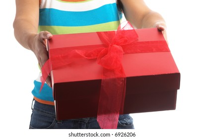 girl holding a red gift box  in hand