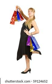 Girl holding shopping bags. Isolated in full length on white background.