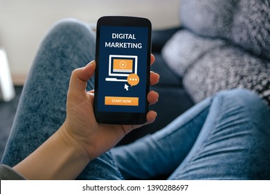 Girl holding smart phone with digital marketing concept on screen